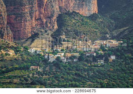 Long Shot Of Riglos Mallets Town Under The Rocks