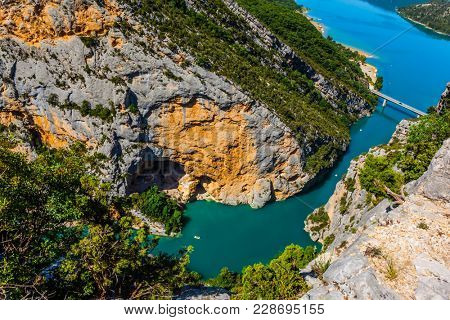 The river Verdon flows along the bottom of the canyon. The water in the river is bright azure.The fascinating journey through the mountain Provence. Concept of active and ecological tourism