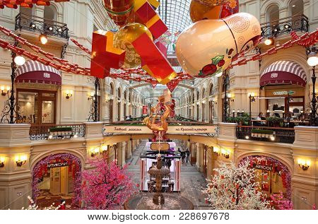 Russia, Moscow - February 15, 2018: Chinese new year decoration and Matreshka over fountain inside russian most famous and oldest State Department Store in Moscow GUM located on Red Square