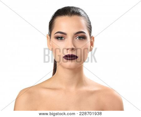 Woman with beautiful makeup on white background. Professional visage artist work