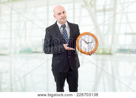 mad businessman with clock at the office