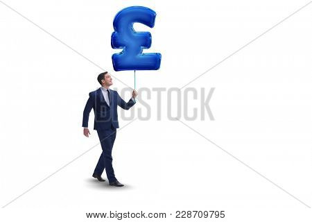 Businessman holding british pound sign inflatable balloon
