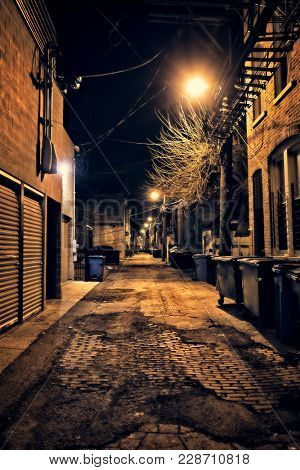 Dark empty and scary urban city street cobblestone