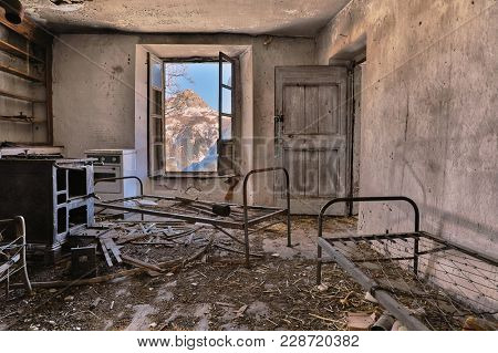 Remains of an abandoned house, panoramic scenery view from the window