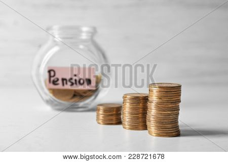 Stacks of coins on table. Pension planning