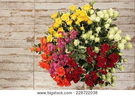 Flower bouquet background. Yellow and red roses.