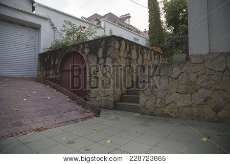 Fragment Of An Yard. There Are Entrance Into The Basement And Into The Yard.