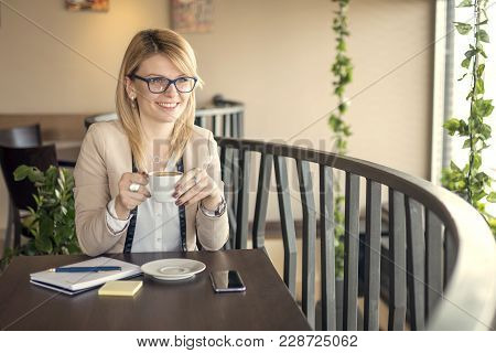 Good Business Talk. Cheerful Young Beautiful Woman In Glasses Talking On Mobile Phone With Smile Whi