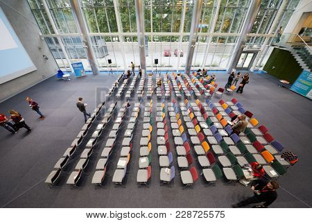 MOSCOW, RUSSIA - SEP 30, 2017: People in auditorium during break of conference Day of Internet Advertising in Headquarters Mail.Ru Group.