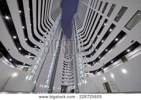 SOCHI, RUSSIA - OCT 7, 2017: Interior of inner space of modern multistoried apartment building Actor Galaxy, low angle view.
