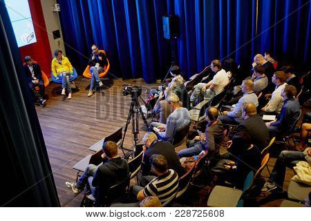 MOSCOW, RUSSIA - SEP 30, 2017: People listening to speaker in auditorium in building of Headquarters Mail.Ru Group during conference Day of Internet Advertising.