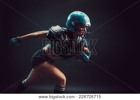 Sexual Sportive Woman Running With Rugby Ball And Screaming Aggressively.
