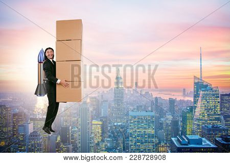 Businessman with jetpack delivering boxes globally