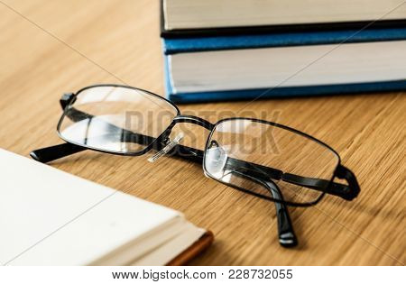 A pair of glasses and books educational, academic and literary concept
