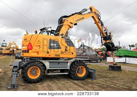 Hyvinkaa, Finland - September 8, 2017: Liebherr A 914 Compact Litronic Wheeled Excavator Demostrates