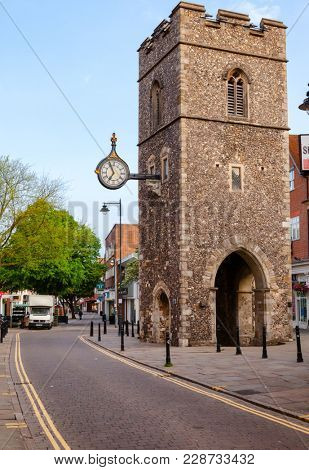 CANTERBURY, UK - JUN 1, 2013: The Clock tower of The Church Of St George The Martyr in Old Town. Canterbury is a historic English cathedral city and UNESCO World Heritage Site