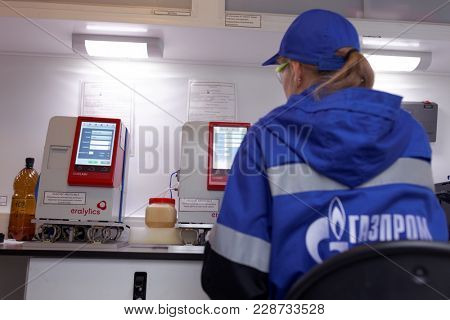 ST. PETERSBURG, RUSSIA - NOVEMBER 9, 2017: Technician working in the mobile quality control laboratory of Gazpromneft company. Laboratory equipment allows to determine more than 10 parameters of fuel