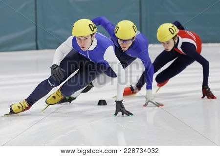 ST. PETERSBURG, RUSSIA - FEBRUARY 18, 2018: Athletes compete in short track speed skating during Pavlovsky Cup. Athletes from 6 countries participated in the competitions