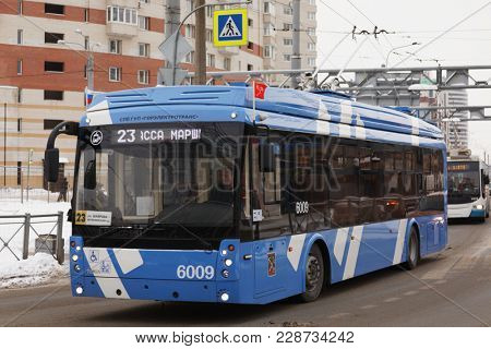 SAINT-PETERSBURG, RUSSIA - FEBRUARY 12, 2018: Trolleybus on line 23 at Komendantskaya square. This bus pass a part of his route using autonomous power supply