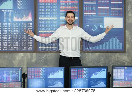 Successful male stock trader in modern office