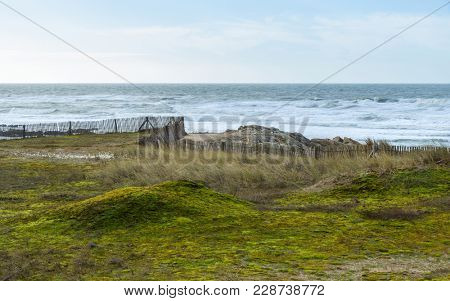 Coastal landscape in Brittany, France. Fence along a pathway