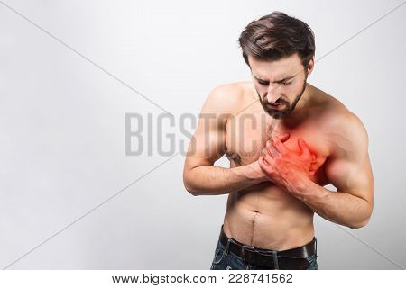 A Picture Of Young And Good-looking Having A Heart Ache In His Chest. It's Is Quite Unusual For His
