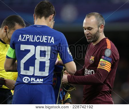 LONDON, ENGLAND - FEBRUARY 20: Cesar Azpilicueta of Chelsea and Andres Iniesta of Barcelona during the Champions League Round of 16 First Leg match between Chelsea FC and FC Barcelona