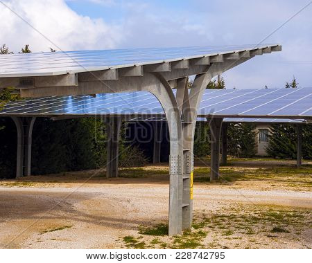 Steel Shed With Solar Panels Installed In The Country