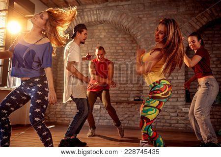 Group of young modern street artist break dancers dancing in the studio. Sport, dancing and urban concept