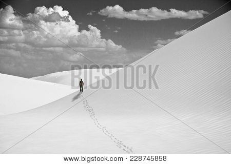 Lonely man in white desert. 3D rendering