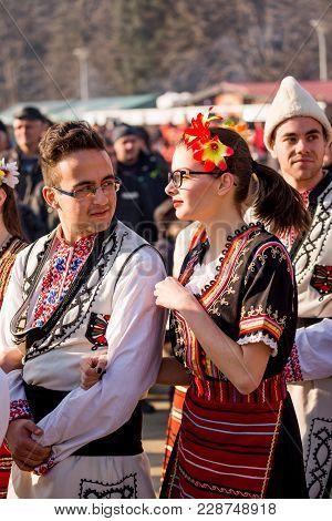 Pernik, Bulgaria - January 26, 2018: Couple Of Dancers In Bulgarian Folklore Costumes Hold And Look