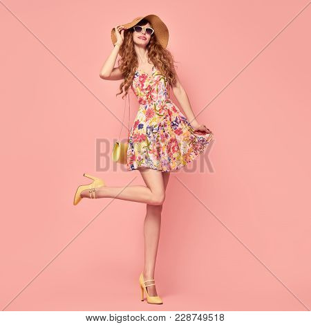 Gorgeous Fashion Lady Smiling In Floral Dress. Trendy Wavy Hairstyle. Sexy Young Model Dance, Stylis