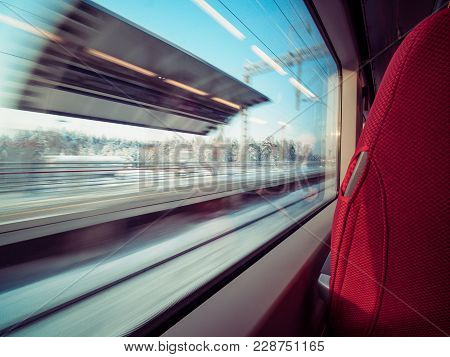 View From Train Window. Motion Railway Platform Through Glass Window Of Railway Carriage. Winter Lan