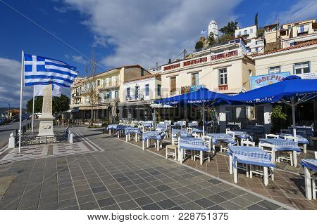 Poros, Greece - January 17, 2018: Restaurants At The Harbor Seafront In Chora Village Of Poros Islan