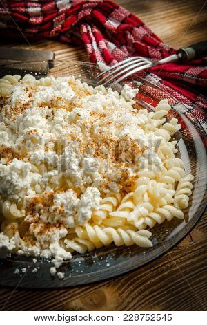 Fusilli Pasta With Cottage Cheese, Sugar And Cinnamon.