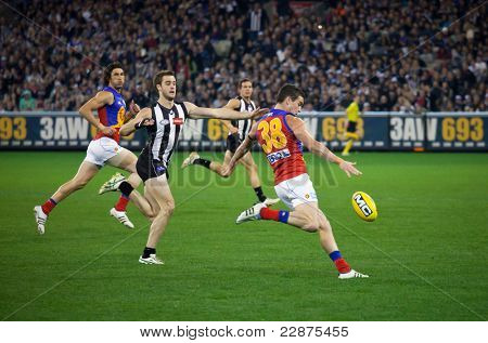 MELBOURNE - AUGUST 20 : Brisbane's  Tom Rockliffe (R) in action during their loss to Collingwood - August 20, 2011 in Melbourne, Australia.