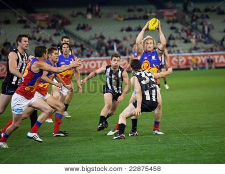 MELBOURNE - AUGUST 20 : Brisbane's Daniel Rich with the ball in heavy traffic during their loss to Collingwood - August 20, 2011 in Melbourne, Australia.