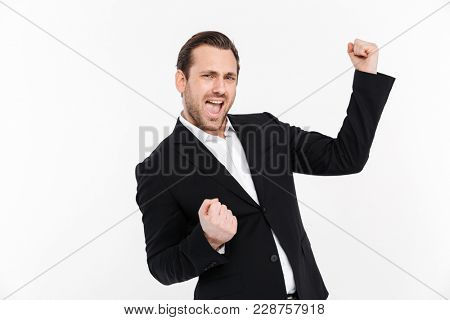 Portrait of happy businessman clenching fists like winner or successful person being happy to achieve his goals isolated over white background