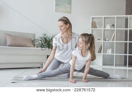 Mother Helping Her Daughter To Do Twine At Home