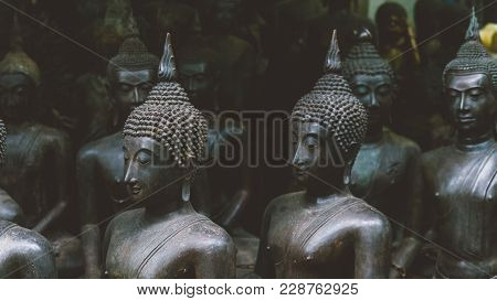 Old Buddha Statues On The Local Market Close-up. Buddha As A Symbol Of Buddhism In Thailand And Asia