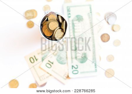 A Bucket With Pennies Dollars On A White Background