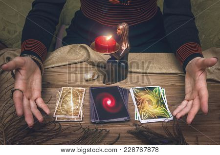 Woman Fortune-teller Chooses A Deck Of Cards For Divination.
