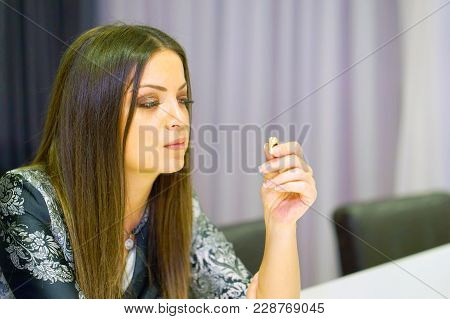 A Young Woman Holding Wedding Engagement Ring In Hands, Engaged Girl Doubts About Marriage Proposal,