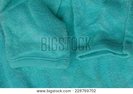Green Fabric Texture Of Clothing With Sleeves