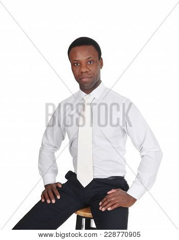 A Portrait Image Of A Serious Handsome Business Man Sitting In A White Shirt And Tie, Looking Into T