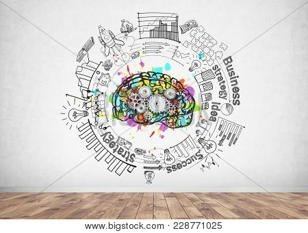 Colorful Brain Sketch With Cogs On It And A Business Idea Sketch Drawn On A Concrete Wall In A Room