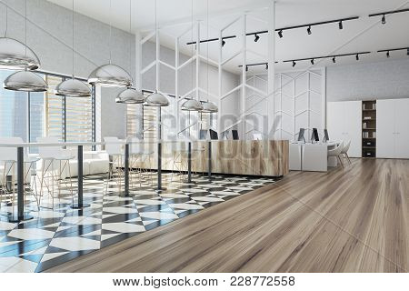 Office Dining Room Corner With White Walls, A Tiled Black And White Floor, White Tables, Stools And