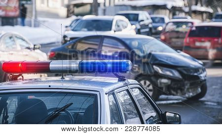 Siren On The Roof Of A Police Car And An Accident On The Road With A Shallow Depth Of Field