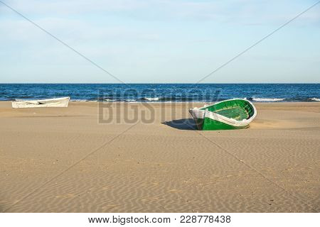 Wrecked Wooden Fisher Boat. Boat Stranded In The Sand Of A Beach Broken Abandoned Boat In Sand, Sea