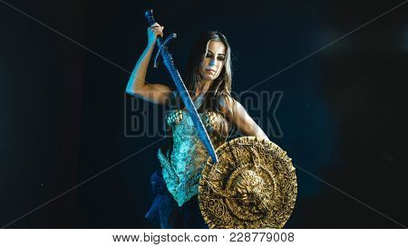 valkyrie warrior, woman with golden armor iron coat and big warrior sword